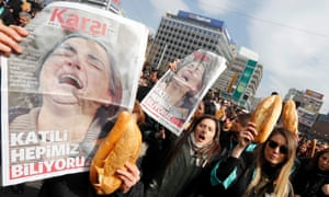 Anti-government protesters carry posters of Berkin Elvan's mother and bread during a demonstration marking the funeral of Elvan in Ankara