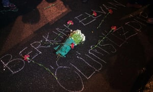 Flowers are thrown to the ground with a sign saying 'Berkin Elvan is eternal' during the protests in the Kadikoy neighbourhood of Istanbul, Turkey.