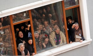Women shout anti-government slogans as they wait for the funeral ceremony of Berkin Elvan in Okmeydani cemevi, an Alevi place of worship, in Istanbul