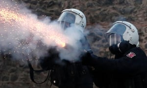 Turkish riot police fires tear gas to disperse protesters in Istanbul, Turkey.
