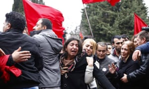 Family members try to calm Gulsum Elvan, Berkin Elvan's mother, during the burial ceremony of the young child in Ferikoy neighborhood cemetery in Istanbul, Turkey