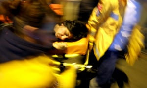 A injured protestor carried to ambulance by health crew personnel during clashes at the funeral of Berkin Elvan.