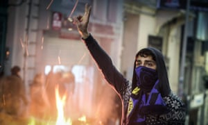 A demonstrator strikes a defiant pose in salute to  Berkin Elvan in Istanbul, Turkey.