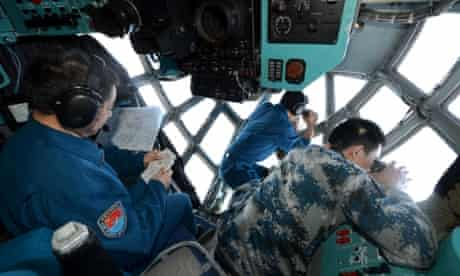 Crew members of Chinese Air Force search the sea areas where the missing Malaysia Airlines flight MH370 lost contact. Multinational search operation to locate missing Malaysia Airlines flight MH370 has been expanded to two areas with more countries joining in on the mission.