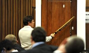 Colonel Johannes Vermeulen holds a cricket bat