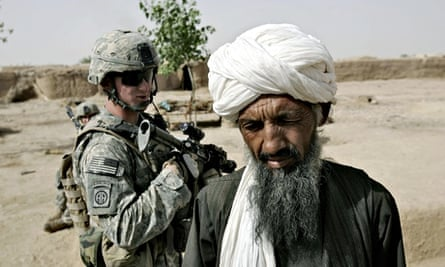A US soldier talks to an Afghan man in Biabanak, 2007