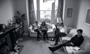 New Order sitting in a front room in 1986.