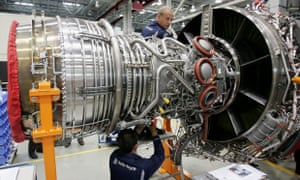 Workers assemble an aircraft jet engineat the Rolls-Royce aircraft engine factory in Berlin.