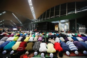 Muslim men offer prayers at the Kuala Lumpur International Airport for the missing Malaysia Airlines jetliner MH370, Thursday, March 13, 2014, in Sepang, Malaysia.