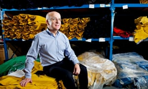 New Balance factory manager Andy Okolowicz sits on bales of fabric