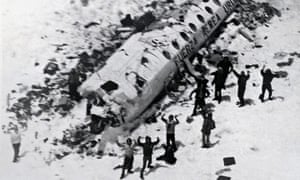 Survivors of the plane crash in the Chilean Andes wave to the rescue helicopter