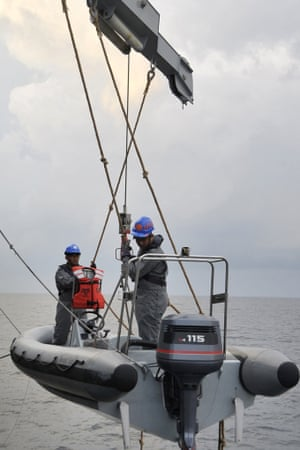 This handout photo taken on March 13, 2014 by the Royal Malaysian Navy and received on March 14, 2014 shows the Royal Malaysian Navy's offshore patrol vessel KD Selangor lowering a boat for observing objects more closely during a search and rescue operation for the missing Malaysia Airlines plane in the Straits of Malacca off the Malaysian coast.