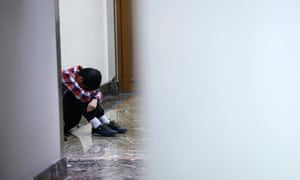 A friend of a passenger onboard the missing flight MH370 cries as he waits for news from Malaysia Airlines at the lobby of a hotel in Beijing, March 14, 2014.