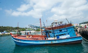 Vietnamese fishermen who have joined in the search of the missing Malaysian flight MH370 rest at a habour in Phu Quoc island on March 13, 2014.