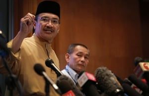 Malaysia's Minister of Transport Hishamuddin Hussein, left and Malaysia Airlines Group CEO Ahmad Jauhari Yahya, right, answers queries from the media during a press conference regarding missing Malaysia Airlines jetliner MH370 in Sepang, Malaysia.