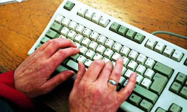Older woman using a computer keyboard