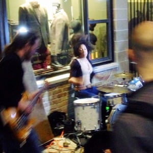 DAMS band playing on a street corner outside an antique store