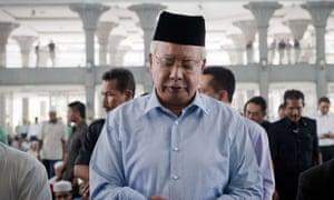 Malaysian Prime Minister Najib Razak prayers for passengers and crew of missing Malaysia Airlines flight MH370 at mosque near Kuala Lumpur International Airport, Malaysia.