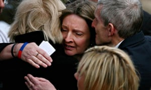 Helen Perry (centre) being consoled at the funeral of her son, Lance Corporal Michael Pritchard