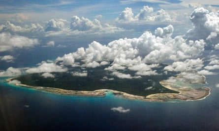 File photographs of clouds hanging over the North Sentinel Island, in India's southeastern Andaman and Nicobar Islands. India used heat sensors on flights over hundreds of uninhabited Andaman Sea islands on Friday, and will expand its search for the missing Malaysia Airlines jet farther west into the Bay of Bengal, officials said.