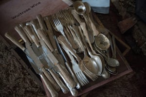 Muddied cutlery is seen in Price's home