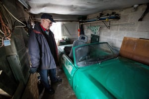 Moorland resident Trevor Fisher, 72, stands beside his damaged sports car