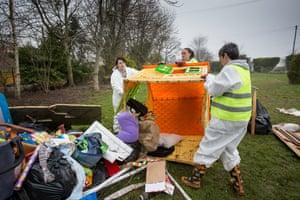 Volunteers help remove flood damaged belongings in Fordgate, Somerset.