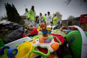 Volunteers from FLAG help remove flood damaged belongings in Fordgate, Somerset.