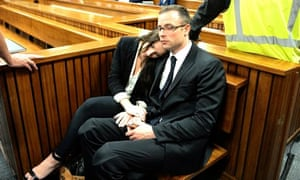 Aimee Pistorius sits with her brother Oscar during his trial for murder in South Africa