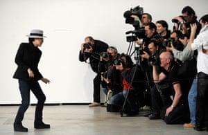 Yoko poses for the photographers.