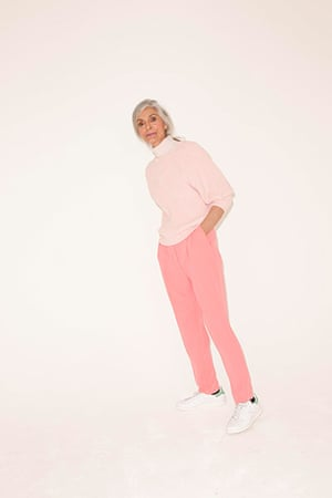 All Ages pink: pale pink jumper pink trousers white trainers