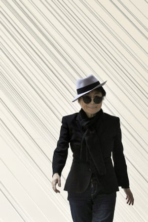 Yoko Ono poses in front of her piece Morning Beams.