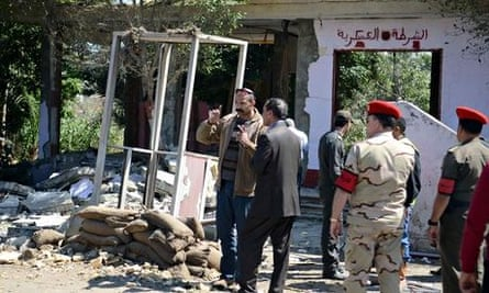 Egyptian soldiers and officials inspect the Cairo checkpoint where gunmen killed five soldiers