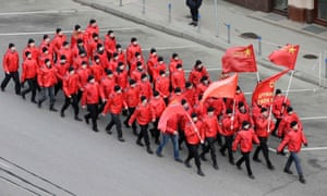 """People march in formation as they participate in the """"Brotherhood and Civil Resistance March"""" in Moscow."""