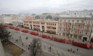 """People march in formation as they participate in the """"Brotherhood and Civil Resistance March"""" in central Moscow."""