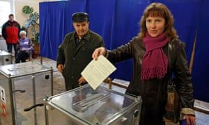 A woman prepares to cast her ballot