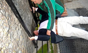 A tourist kisses the Blarney Stone – which researchers now say is Irish in origin.