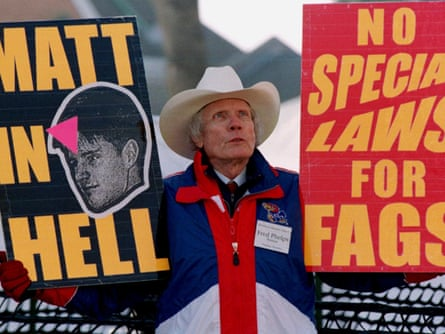 Pastor Fred Phelps Sr displays provocative placards in Laramie, Wyoming in April 1999