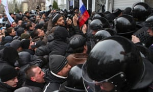 Pro-Russian demonstrators scuffle with police in Donetsk.
