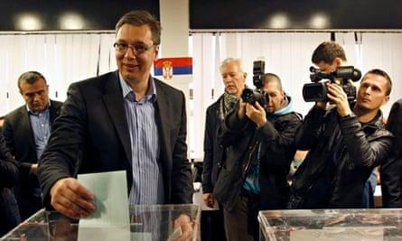 Progressive party leader Aleksandar Vucic casts his ballot at a polling station in Belgrade.