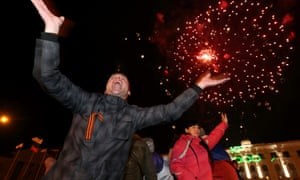 People celebrate as the preliminary results of today's referendum are announced on Lenin Square in the Crimean capital of Simferopol March 16, 2014. russia ukraine