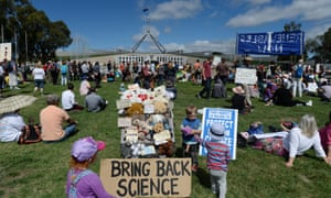 Hundreds of people attend the March in March protest outside Parliament House in Canberra.