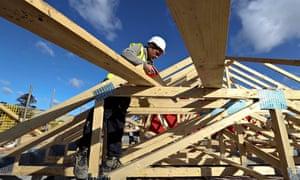 A workman building a house