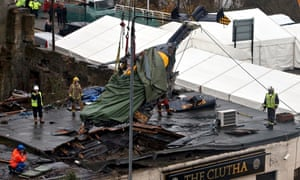 The Super Puma police helicopter is lifted from the roof of the Clutha on 2 December 2013