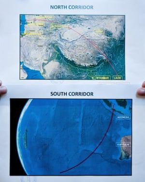 Two satellite maps of the possible location of the missing Malaysia Airlines flight MH370 shown during a press conference in Kuala Lumpur.