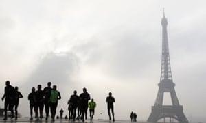 People jog on the Esplanade du Trocadero in front of the Eiffel tower 4 in Paris.
