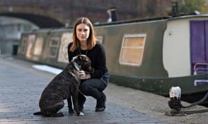 Paula Haydock outside her houseboat with Rupert.