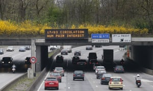 Cars drive under a road sign reading'' 17/03 from 5h30 traffic for even numbers forbidden'' on the Parisian ring road, on March 17, 2014 as Paris resorted to drastic measures to curb soaring pollution levels by forcing all cars with number plates ending in even numbers off the road for the first time in two decades. Around 700 police officers were deployed to man 60 checkpoints around the French capital to ensure that only cars with number plates ending in odd numbers were out on the streets.