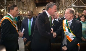 New York mayor Bill de Blasio greets grand marshal of the 2014 New York St Patrick's Day Parade, Jack Ahern, before a service at St Patrick's Cathedral in New York.