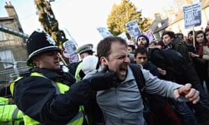 Police and anti-fascist protesters clash in Cambridge